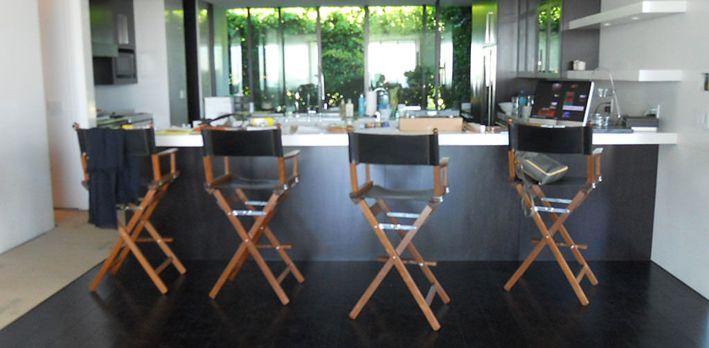 High director's chairs at a kitchen counter